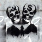 Grafitti of two skulls in a suit