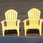 Two yellow plastic armchairs on boardwalk outside Seattle Aquarium