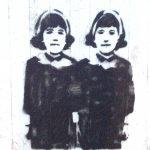 Black grafitti stencil on wall of twin sisterswith headband and scarffs